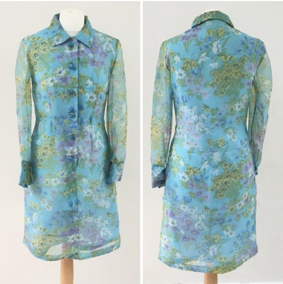 1970s vintage cocktail dress with blue floral chiffon and beaded buttons, sheer long sleeved shirt dress, with lilac and yellow flowers