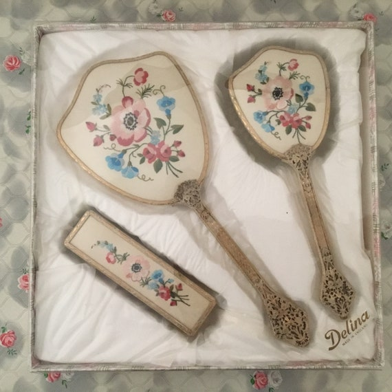 Delina three piece vanity dresser set with hairbrush, hand mirror, and clothes brush, c1960 vintage set with embroidered pink flowers