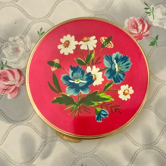 Red loose powder compact, c1950s with blue and white flowers, vintage British made makeup mirror