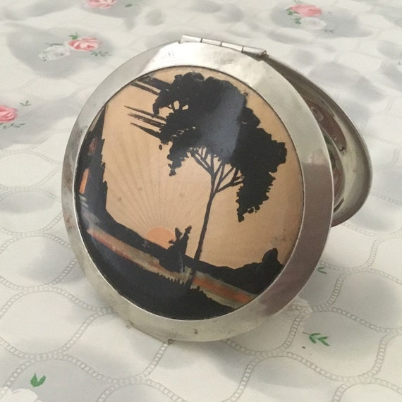 Loose Powder compact c1930s or 1940s, with faux guilloche enamel sunset, and hand painted silhouette of a Victorian couple, tree and church
