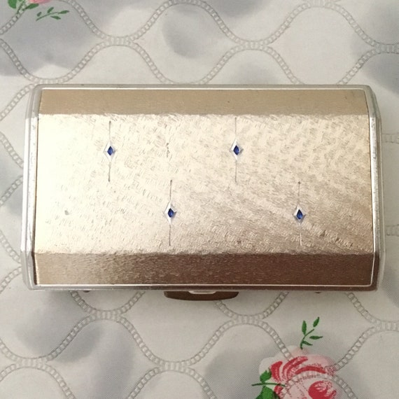 Colibri vintage ladies cigarette case, silver metal with blue details and vanity mirror, c 1960s or 1970s