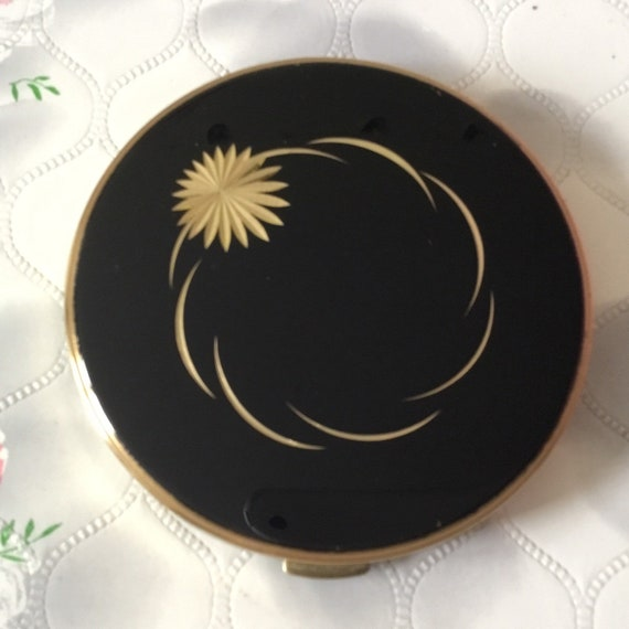 Margaret Rose powder compact,  gold tone makeup mirror with black lid and flower, c 1960s or 1970s vintage handbag accessory,