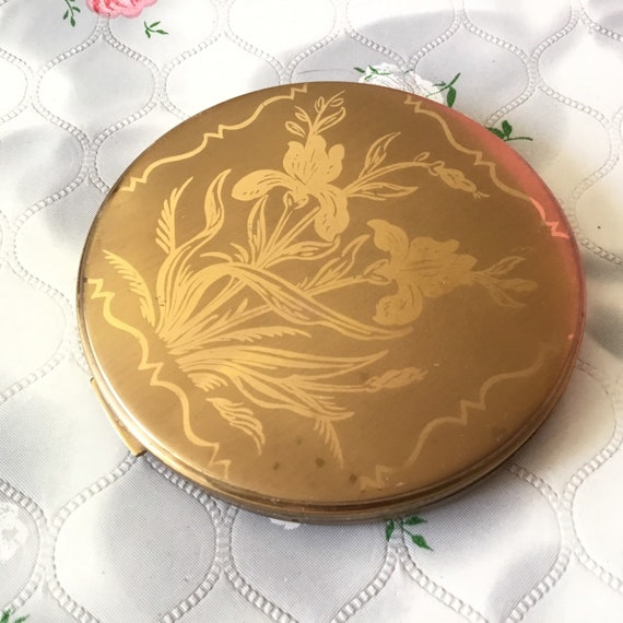 Vintage Vogue Vanities loose powder compact, goldtone with lillies, c1950s
