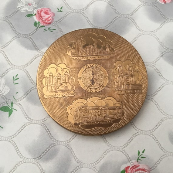 Vintage souvenir powder compact with London landmarks, c1950s, gold metal handbag makeup mirror with Buckingham Palace, Tower London, Eros