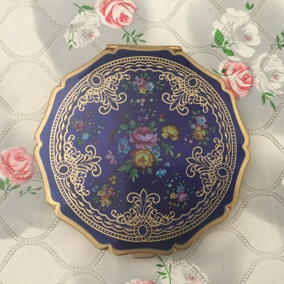 Stratton Queen convertible powder compact, c1970s or 1980s, gold tone and blue makeup mirror, with roses