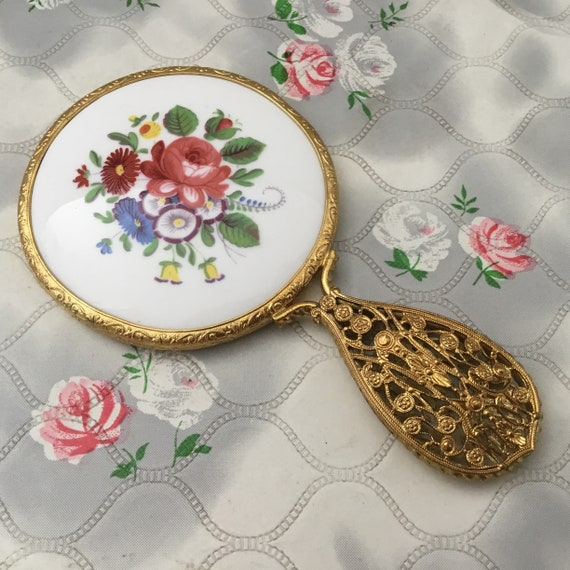 Mini hand mirror with floral porcelain tile, mid-century makeup mirror with pink and blue flowers c 1950s