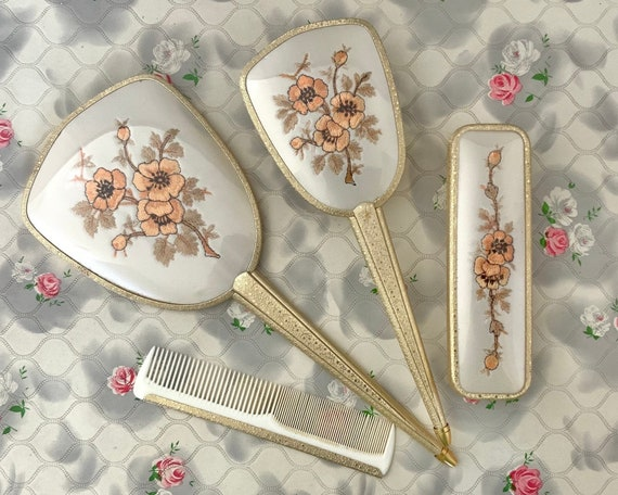 Embroidered dresser set with hairbrush, hand mirror, clothes brush and comb, vintage mid century gold vanity set with peach flowers