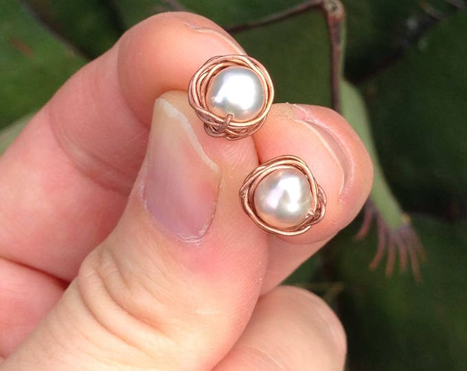 Pearl stud earrings with Sterling silver base and copper nest