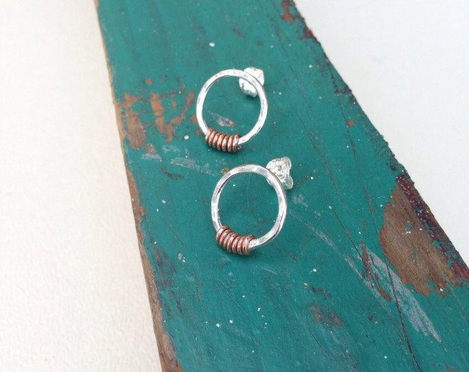 Hammered silver circle post earrings with copper twist