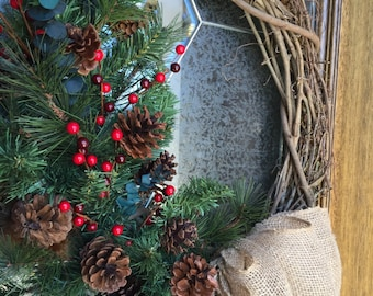 rustic christmas wreath rustic holiday wreath burlap bow red berries pine cones feathers grapevine wreath