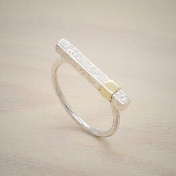 Handmade silver minimal  ring with texture and golden motive, silver bar ring