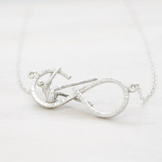 Handmade silver infinity symbol necklace with chain and miniature figure, infinity necklace with texture, Submanity collection