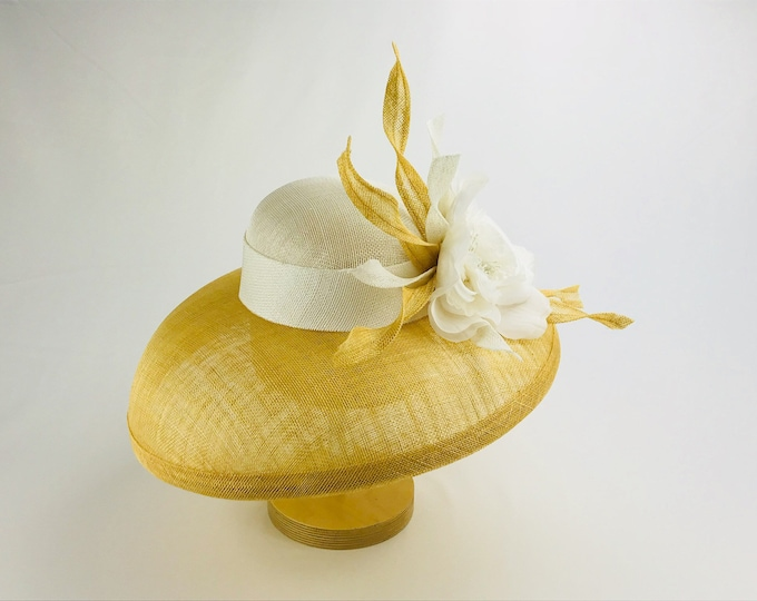 Tan and white wide brim sinamay hat with white silk flower and feathers