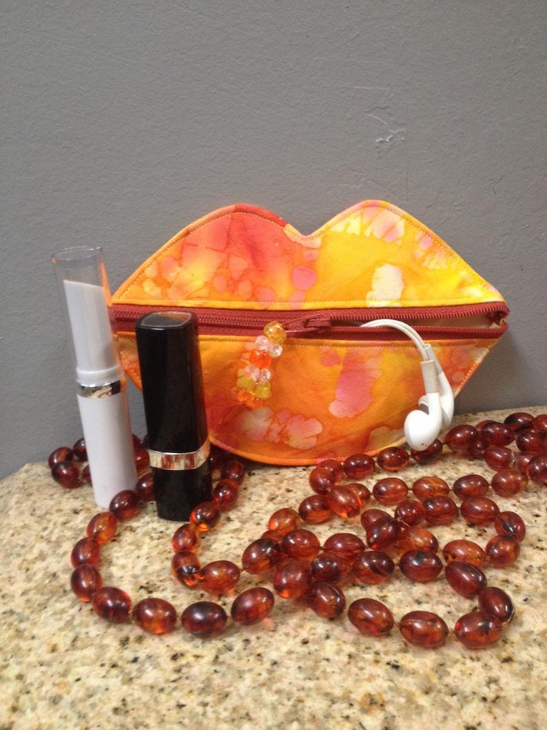 Lip coin purse-ear bud holder lipstick case
