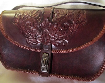 Large vintage western hand tooled leather handbag.