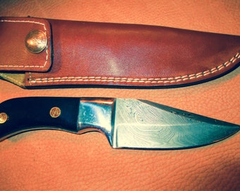Custom Hunting Knife with Damascus Blade and cusotm leather sheath.