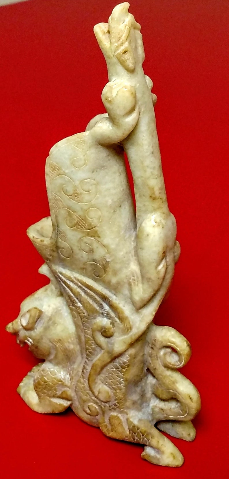 rhyton Early Chinese pale jade drinking horn shaped vessel with mythical creatures in high relief.