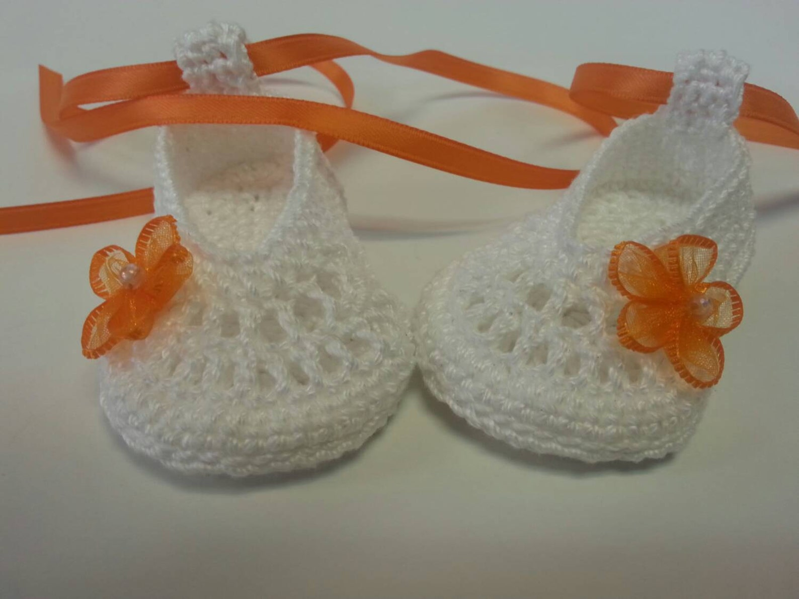 cute infant ballet slippers with orange flowers and ribbon