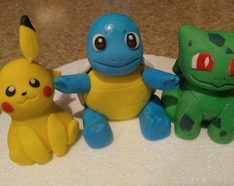 Pikachu and friends , Squirtle, Bulbasaur and Charmander cake toppers.