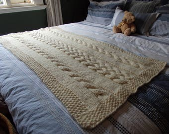 Hand knitted cream cable throw or bed runner
