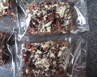 9 individually wrapped chocolate brownies.