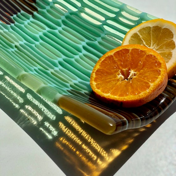 Honey Comb fused glass tray in red amber, pale yellow and aqua green transparent colors.
