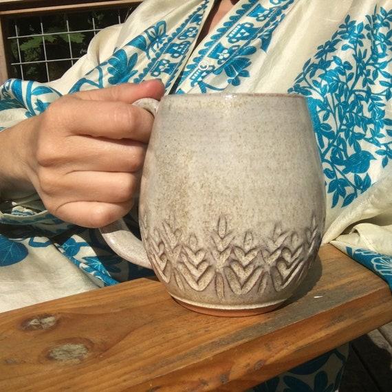 Carved coffee mug in white speckled glaze