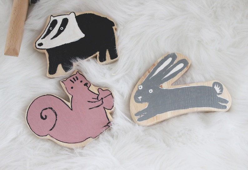 Wooden toys animal shaped: a badger a rabbit a squirrel image 0