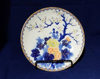 Beautiful vintage collectible Japanese plate with a cherry blossoms and flower design.