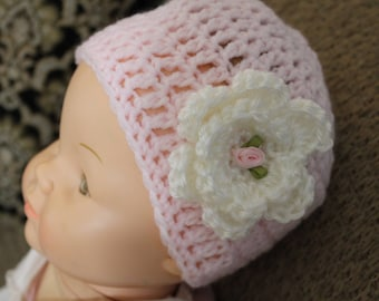 Pink Crocheted Hat with Crocheted flower with rosette in the middle of flower