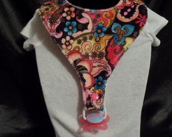 Pacifier bib for ages 6 months to about 2 years.