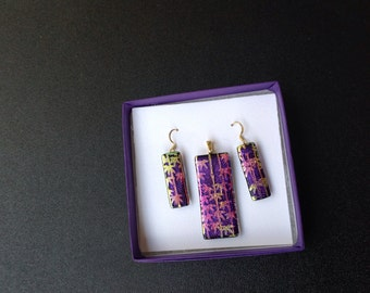 Dichroic glass pendant earring set.  Pastel bamboo design over violet swirls.