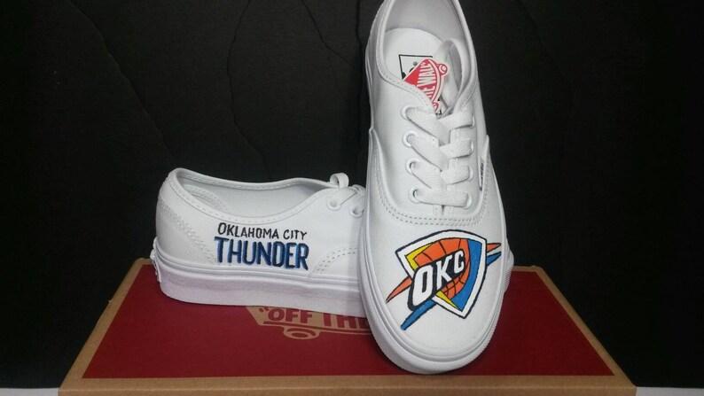 Custom made Oklahoma City Thunder vans