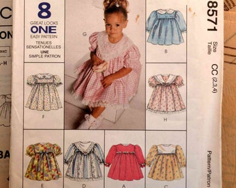 McCalls 8571. Toddler Girl's Easter Dress Pattern With Long or Short Sleeves and Optional Decorative Collar in 8 Styles.  Size 2,3,4.