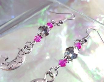 Moon and stars in beautiful dangling earrings.