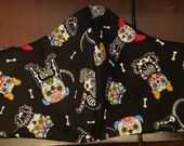 Large cotton fabric facemask with sugar skull dogs.