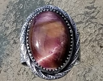 Adjustable Sterling Silver Ring with Pink Tiger Eye Cabochon surrounded by sterling twisted wire (size 5 - 10)