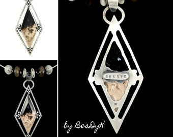 Pendant with Petrified Palmwood cabochon set in sterling silver on collar chain with African Glass beads and black onyx by BeaDyK.