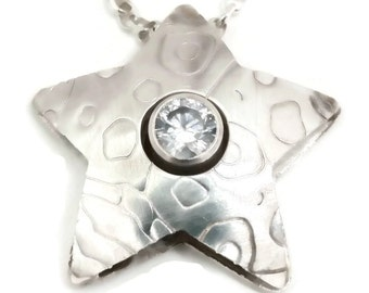 "Original design by BeaDyK Sterling silver star shaped ""Pillow"" pendant set with a clear CZ on sterling rolo chain"