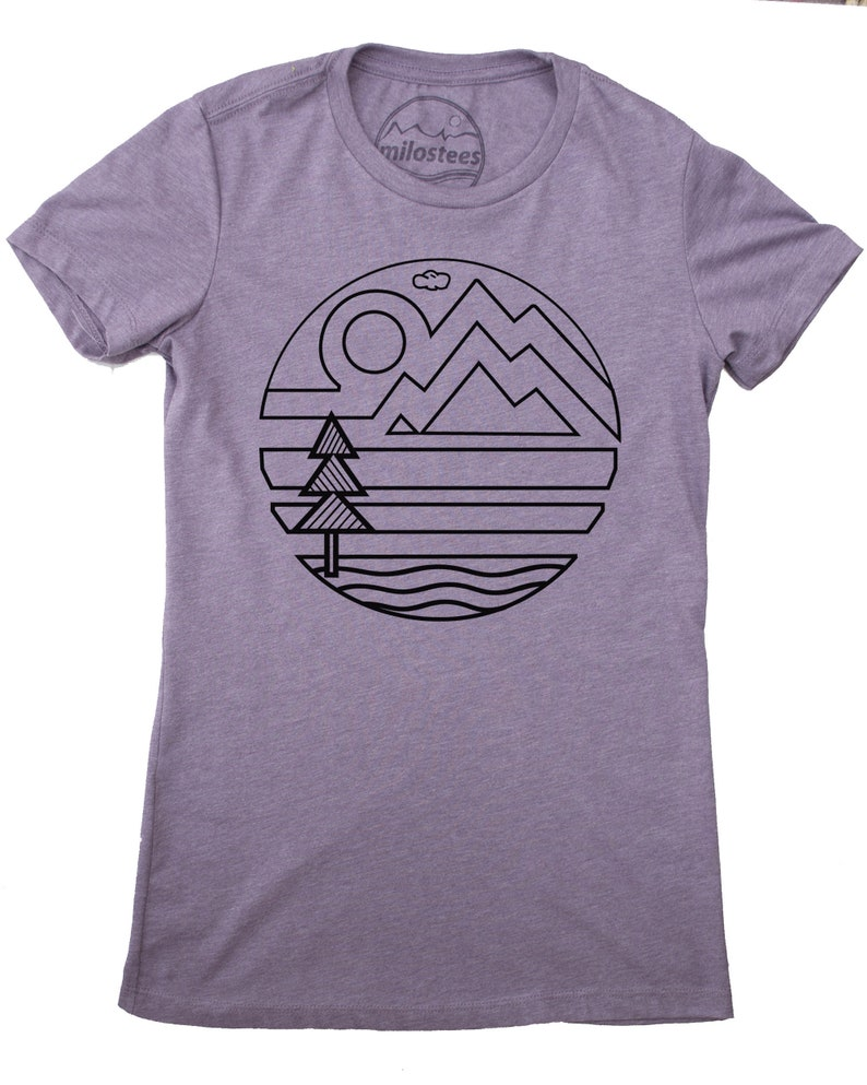 Simple outdoors T shirt original nature print on a light purple hue in form fitting style for her with sun earth tree and water design.