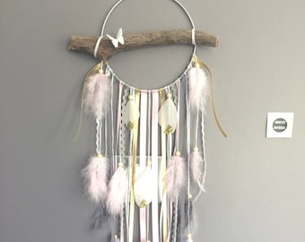 Dream catcher with driftwood, and feathers in shades of pink, gray, white and gold glitter