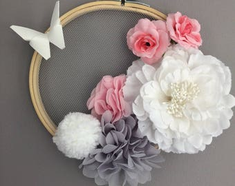 Wall hanging pom poms and fabric flowers with butterfly
