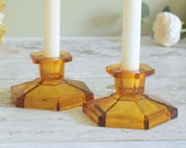 Pair of gorgeous amber vintage glass candlesticks from the 1940's.