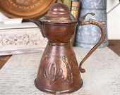 Small vintage boho copper tea or coffee pot from the middle east, decorative embossed.