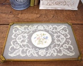 Pretty dressing table tray. Glass inset with pastel floral embroidery and lace design.