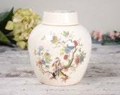 Vintage ginger jar with lid, glazed ceramic with brown and pink oriental floral design