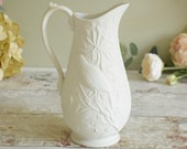 White embossed porcelain jug or pitcher by Portmeirion.
