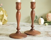Pair of vintage solid walnut wooden candlesticks