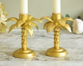 Pair of gold palm tree shaped candlesticks