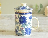 Vintage blue oriental design lidded ceramic mug, with removable matching strainer
